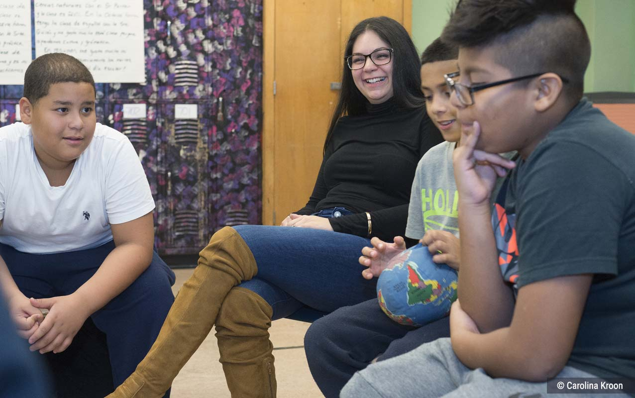 Students and a PAZ Program Director participating in a circle