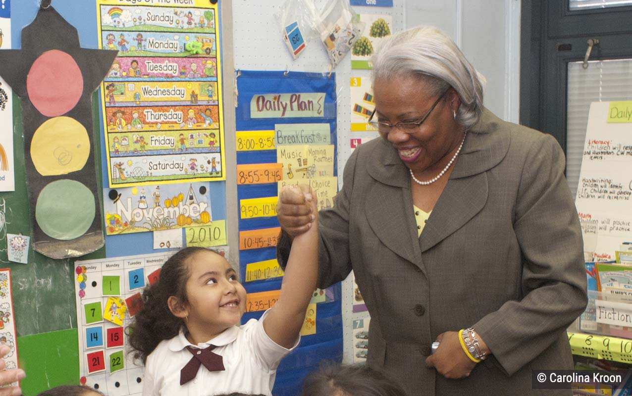 Principal Roberta Davenport at a 4Rs school with student